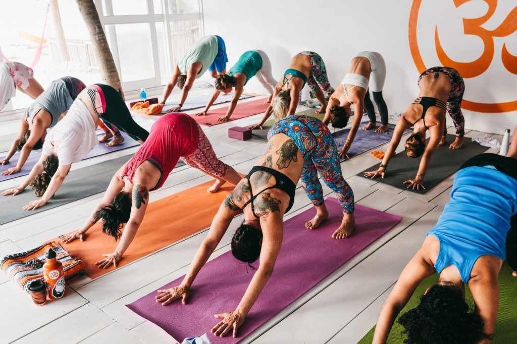SwellWomen guests enjoy yoga in an open-aired studio