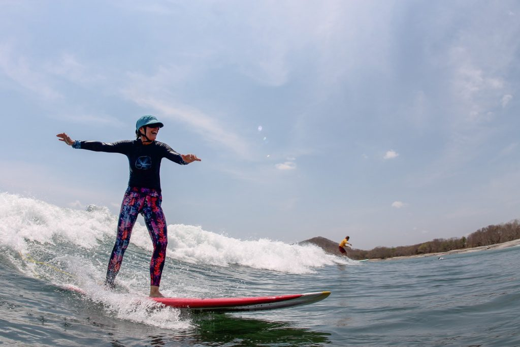 Women having fun and surfing on the water